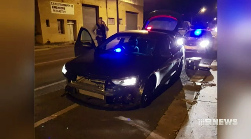 A police car was rammed up to eight times as the car thieves escaped.
