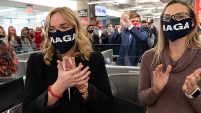 Campaign workers applaud after President Donald Trump speaks at the Trump campaign headquarters on Election Day, Tuesday, Nov. 3, 2020, in Arlington, Va. (AP Photo/Alex Brandon)