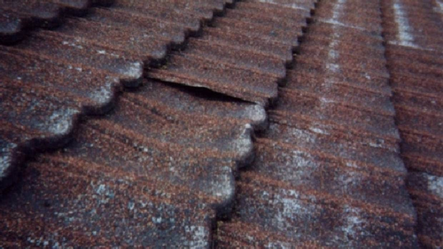 Hazmat says some versions of mastic or bitumen-based pressed metal roof tiles produced prior to the early 1980s contain asbestos.