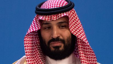 Mohammed bin Salman is waiting for the family photo of all participants at the G20 Summit Conference Centre in Buenos Aires.