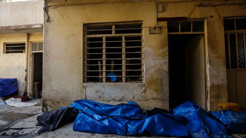 Body bags pile up in a garage after they were recovered from a house destroyed by a reported air strike in the al-Jadida neighbourhood of Mosul, March, 2017.