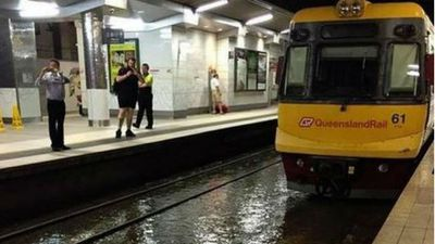 Queensland Rail cancelled all city services after flood waters pooled in several train stations. (Supplied)