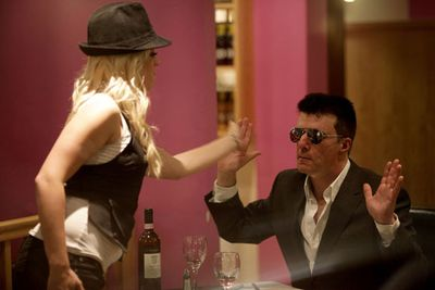 Celebrity impersonators <B>Andy Monk</b>, 52, and <B>Michaela Weeks</b>, 27, shocked fellow diners when they staged a mock fight in the middle of an Indian restaurant in London.