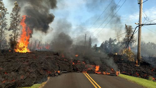 Lava has destroyed up to nine homes in Hawaii. (AAP)