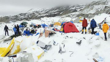 Dozens of tents lie damaged after an avalanche plowed through Mount Everest base camp. (AAP)