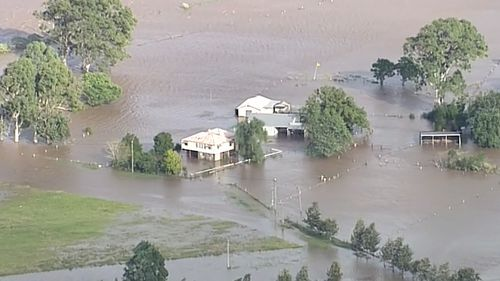 Floodwaters inundate buildings. (9NEWS)