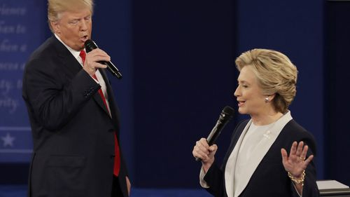 In this 2016 file photo Republican presidential nominee Donald Trump and Democratic presidential nominee Hillary Clinton speak during the second presidential debate at Washington University.