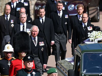 The royal family walk in procession behind Prince Philip's coffin