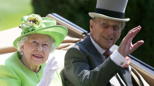 Queen Elizabeth II and her husband Prince Philip, Duke of Edinburgh travel by horse-drawn carriage as they arrive on day one of the Royal Ascot horse racing meet last year.