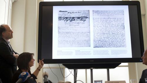 New segments of Anne Frank's diary are displayed at the The Anne Frank Foundation office. (AAP)