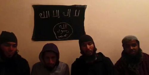 The four men accused of killing the two backpackers appear in a video apparently pledging allegiance to ISIS. (Supplied)