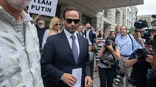 George Papadopoulos, the Trump campaign adviser who triggered the Russia investigation, has been sentenced to 14 days in prison by a judge who said he had placed his own interests above those of the country.
