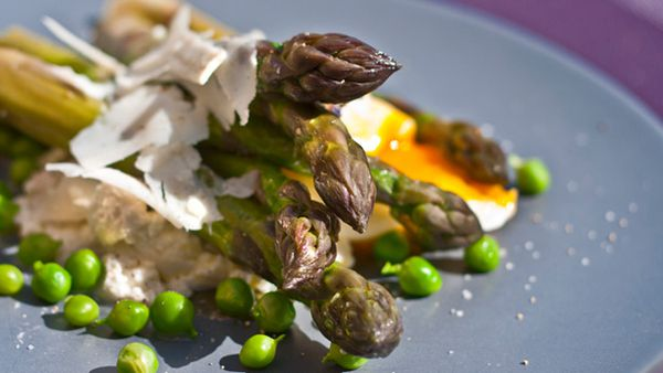 Crisp asparagus and sweet pea salad with poached egg and goats curd