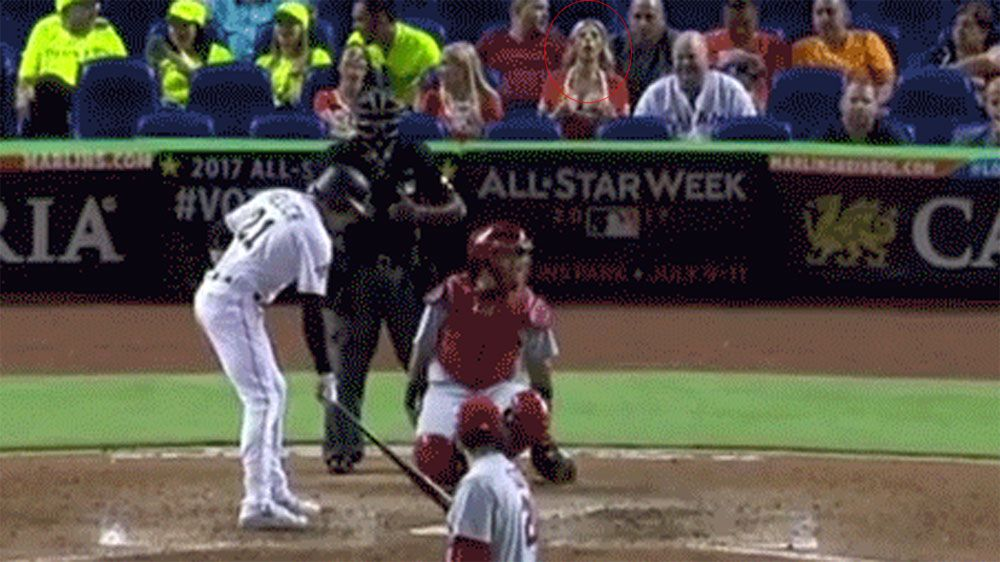 Miami Marlins fan flashes St Liouis Cardinals pitcher Brett Cecil