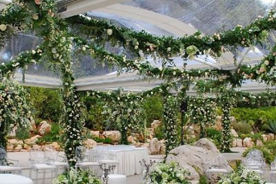 "As guests sipped on champers and took celeb selfies, Italian florists Munaretto took care of the lavish tablepieces. <br/><br/>According to <I>E! News</i>, the floral decoraters ""are quite expensive,"" with an excellent arrangement ""not costing less than <b>$250,000</b>"". <br/>"