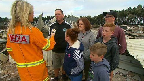 The Terang family return to their home, counting the damage after the horrific fires. (9NEWS)