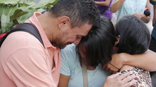Seventeen people have been killed at a crowded nightclub in Venezuela's capital on Saturday after a tear gas device exploded during a brawl and triggered a desperate stampede.