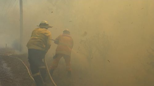 A firefighter on the ground suffered a heart attack and at least three homes were heavily damaged.