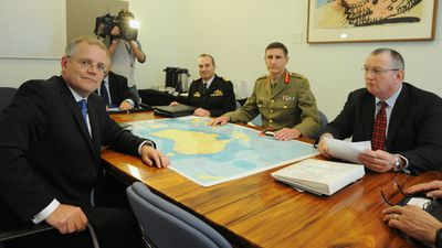 <p>After six years in opposition Mr Morrison was finally in government.</p> <p>Here the minister for immigration meets with newly appointed Lieutenant General Angus Campbell (centre right) at Parliament House in Canberra, on September 19, 2013.</p> <p>Lt Gen Campbell was appointed to lead the government's highly-publicised 'Operation Sovereign Borders'.</p>