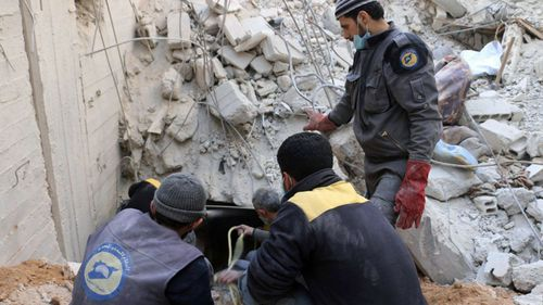 White Helmet volunteers search for survivors amid the rubble of Ghouta. (AP).