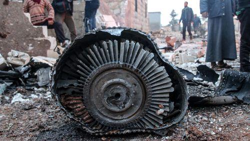 The plane was downed in Ma'saran village near Saraqeb city, in Eastern Idlib, Syria. (AAP)