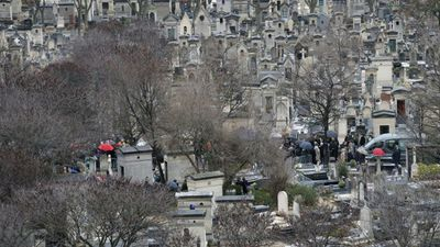 Relatives gather for the burial of French cartoonist Georges Wolinski at Montparnasse cemetery, in Paris. (AP)