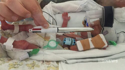 Mila weighed less than 600 grams when she was born and was barley longer than a pen. (9NEWS)
