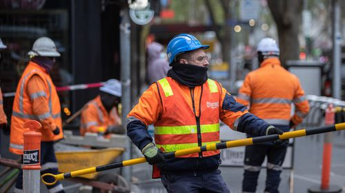 Construction workers returns in Melbourne CBD.