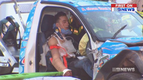 Witnesses say the 21-year-old had his arm out of the window when he crashed into the taxi. (9NEWS)