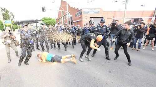 Capsicum spray used by riot police. (AAP)