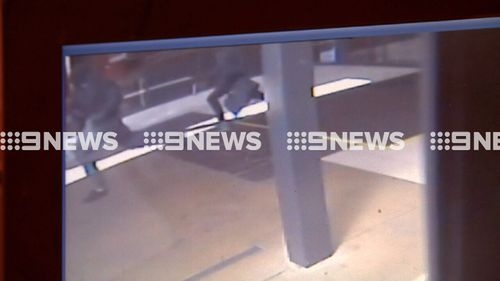 The masked robbers were caught on CCTV fleeing the scene. (9NEWS)