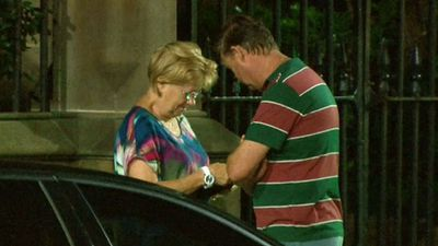 Family members of the hostages stand by at St James. (9NEWS)