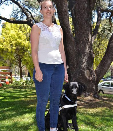 Steph with guide dog, Rocky.