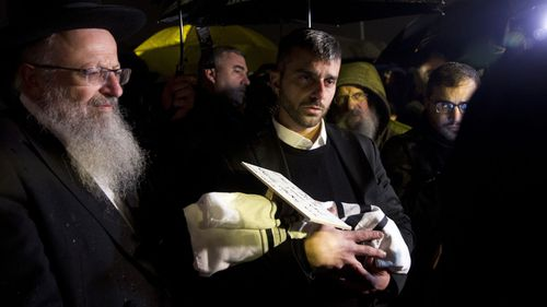 Israelis attend the funeral of the baby of Amichai and Shira Ish-Ran family who died after being delivered prematurely following the drive-by shooting attack near the Israeli settlement of Ofra in West Bank, on 12 December