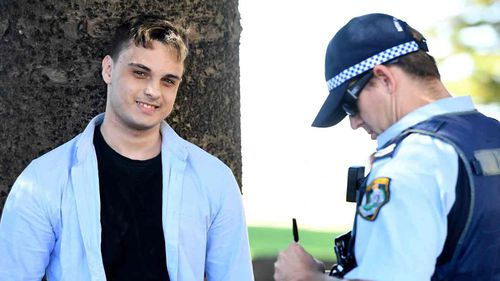 The teen smiles at the camera as he is questioned by police.