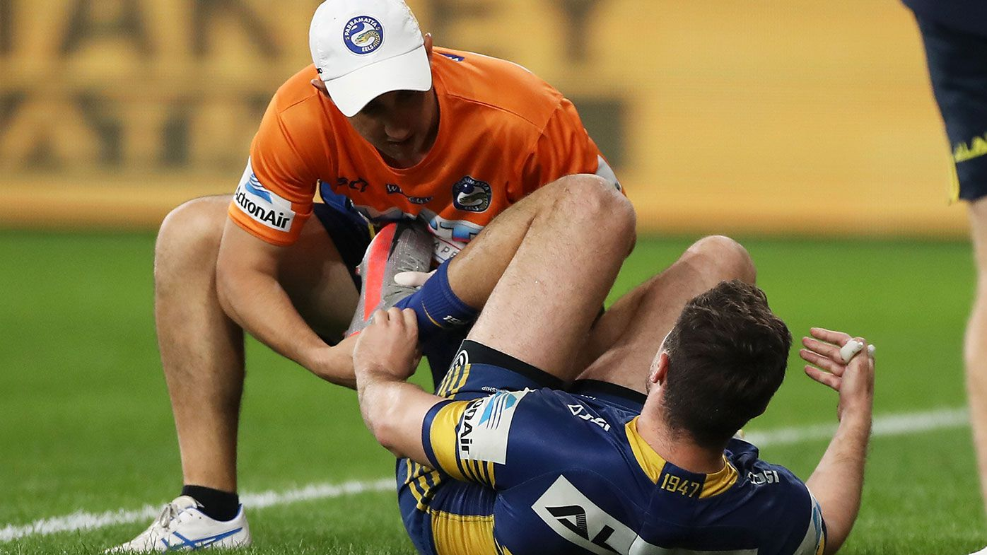Eels star Mitchell Moses is treated for a calf injury in Parramatta's win over Canberra.