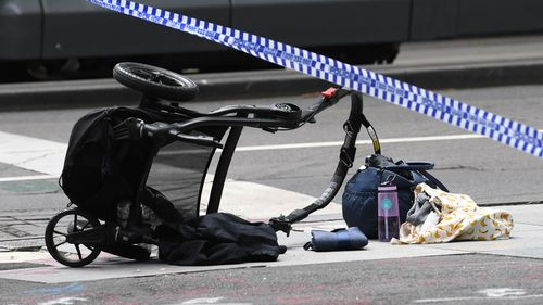 The upturned pram after it was struck by the car on Bourke Street. (AAP)