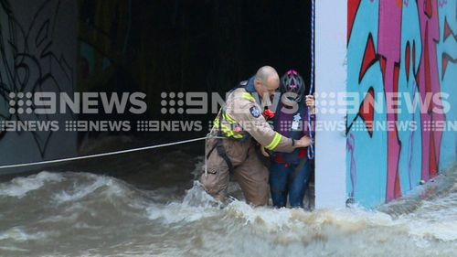 """""""Fire crews with personal floatation devices approached the family, """" Greg Bardock from the MFB told 9News."""