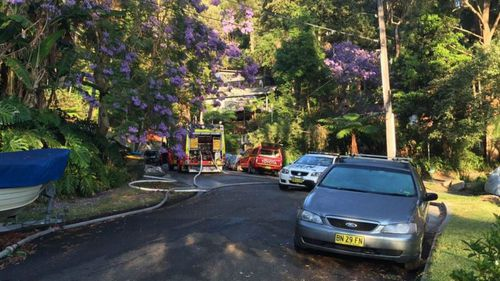 Police and firefighters are still at the scene, four hours after the blaze broke out in the northern beaches house. (9NEWS)
