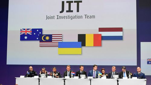 Members of the Joint Investigation Team present the findings into downed flight MH17. (AFP)