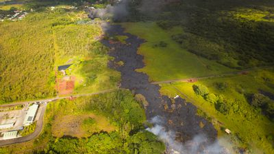 The lava flow has cut a path across Big Island since the volcano erupted. (Getty)