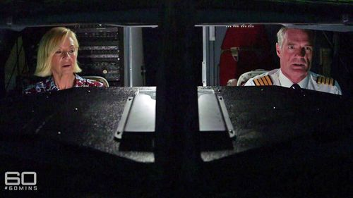 Reporter Liz Hayes sits in a flight simulator with veteran 737 UK pilot Chris Brady.