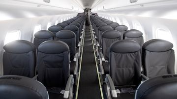 An almost empty British Airways passenger plane flies from Milan to London on March 5, 2020