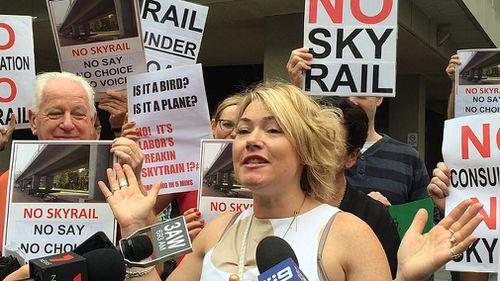 Carnegie resident Karlee Browning and supporters of the No Sky Rail movement protest in Melbourne in February 2016. (AAP)