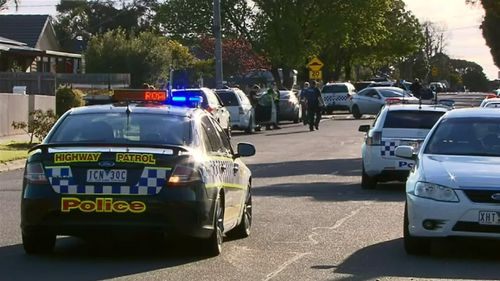 One man surrendered but another held police at bay for a short time. (9NEWS)