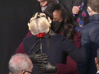 Michelle Obama and Lady Gaga hug at Joe Biden's inauguration