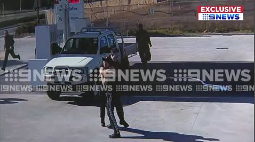 The vision obtained exclusively by 9NEWS shows the man running from police after an alleged car  chase before appearing to surrender.