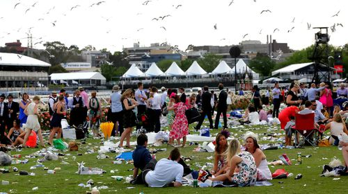 Racegoers relax at the track. (AAP)