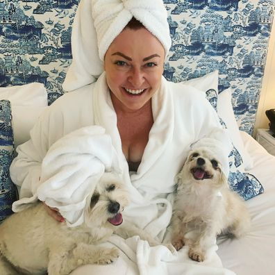 Shelly Horton in bed with her dogs