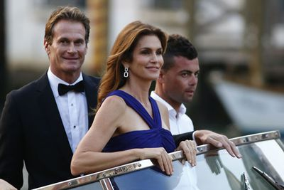 Supermodel status! <br/><br/>Cindy Crawford and hubby Rande Gerber take their water taxi to the star-studded wedding.